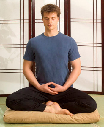 cross legged sitting posture for meditating