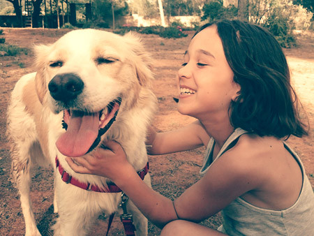 Happiness in the Faces of a Child and a Dog